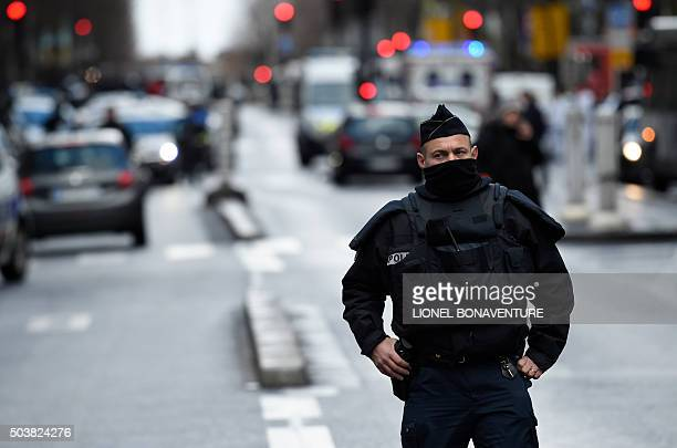 A French police officer is seen at the Boulevard de Barbes in the north of Paris on January 7 after police shot a man dead as he was trying to enter...