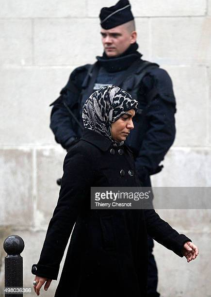 French police officer stands as a Muslim woman leaves the Great Mosque of Paris after the Friday prayers on November 20 2015 in Paris France...