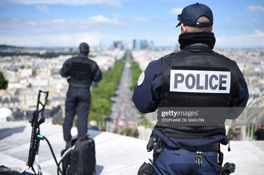 A French Police Officer Stands Next To An Anti Drone Gun On Top Of The Arc De Triomphe During Annual Bastille Day Military Parade Champs Elysees