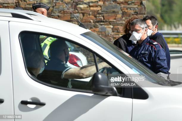 French police officer wearing face mask check documents of a driver at the French border with Pas de la Casa, on June 1 as the Andorran government...