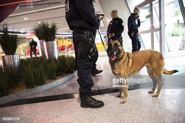 French police officers and a sniffer dog patrol a terminal building at Charles de Gaulle airport, operated by Aeroports de Paris, in Roissy, France,...