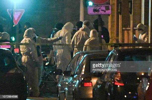 TOPSHOT French police officers and forensics search for evidences at the site where Cherif Chekatt the alleged gunman who had been on the run since...