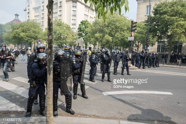 French police officers are seen standing on guard during the May Day protest in Paris May Day is a public holiday celebrated normally on 1 May The...