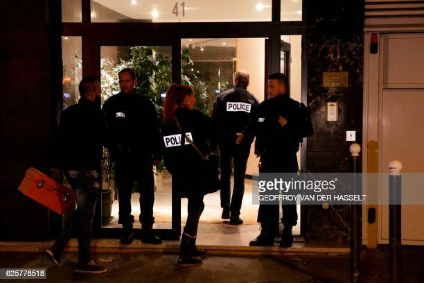 French police officers arrive at the building where British photographer David Hamilton was found dead at his home on November 25 2016 in Paris...