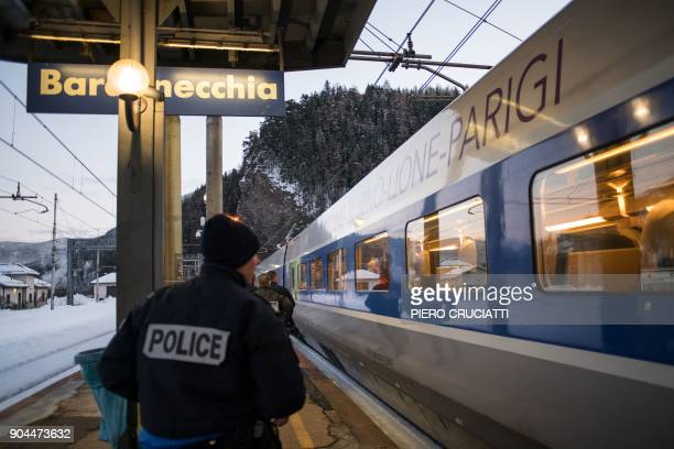 French police officers board a TGV train coming from Milan and direct to Paris to control passengers on January 12 2018 at the Bardonecchia train...