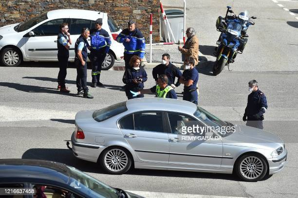 French police officers check documents of drivers at the French border with Pas de la Casa, on June 1 as the Andorran government has revealed plans...