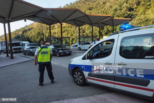 French police officers control vehicles coming across the border from Spain near Le Perthus southern France on August 18 following two...