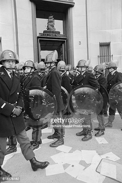 French police officers in riot gear stand outside the Ministry for the Merchant Navy in Paris where they are attempting to evacuate the Minister...