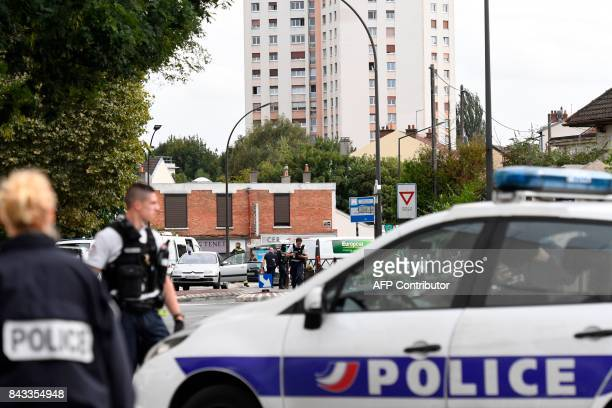 French Police officers intervene at the site where they discovered explosives and bomb components in an apartment in Villejuif a suburb of Paris on...