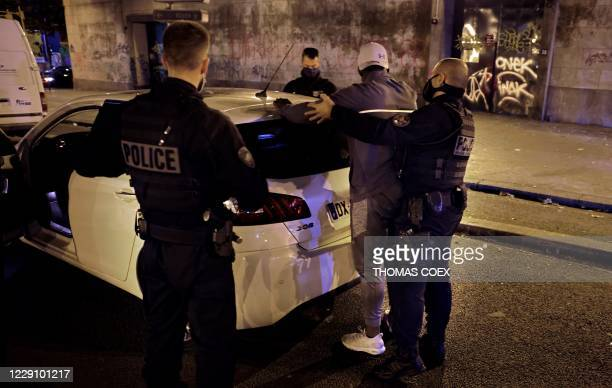 French police officers of the anti-crime squad, Brigade Anti-Criminalite de nuit search a man during a control in Paris, on October 16, 2020.