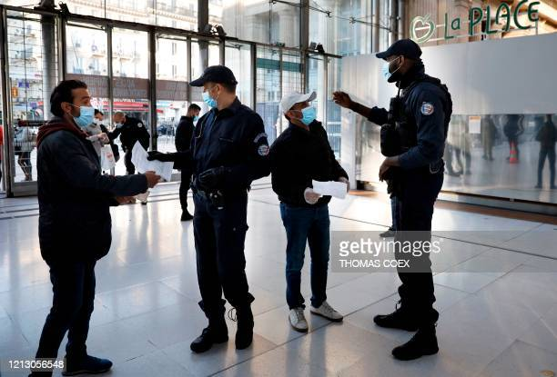 French police officers patrol and control commuters at the Paris' Gare du Nord train station during rush hour in Paris on May 15 as France eases...