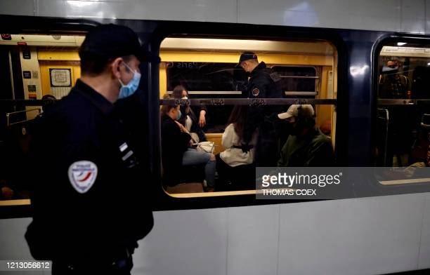 French police officers patrol and control Regional Express Network's commuters at the Paris' Gare du Nord station during rush hour in Paris on May 15...