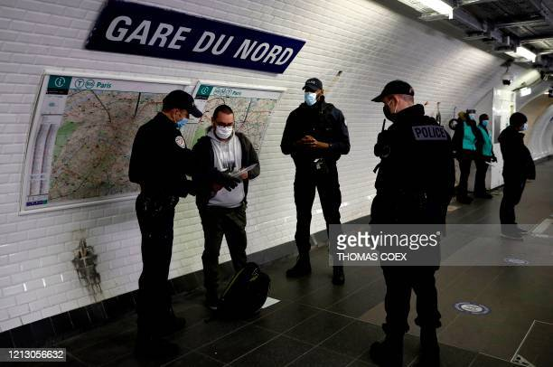 French police officers patrol and control subway commuters at the Paris' Gare du Nord train station during rush hour in Paris on May 15 as France...