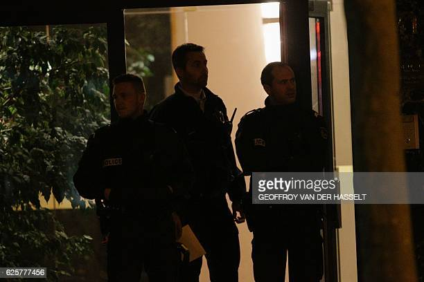 French police officers stand guard at the entrance of the building where British photographer David Hamilton was found dead at his home on November...
