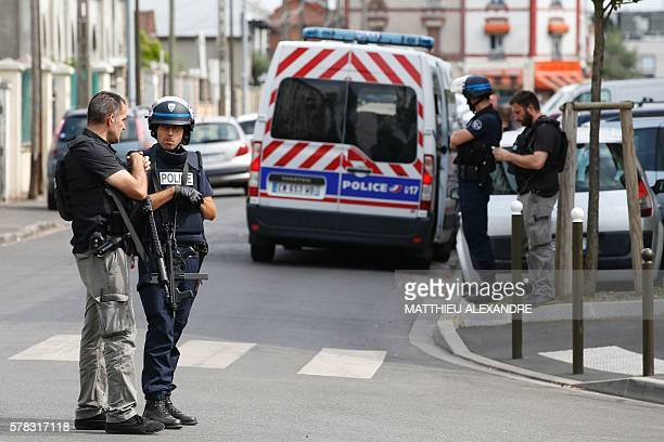French police officers stand guard during an antiterrorist operation on July 21 2016 in Argenteuil northwestern suburbs of Paris Searches are being...
