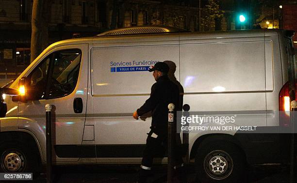 French police officers stand guard near the entrance of the building where British photographer David Hamilton was found dead at his home on November...
