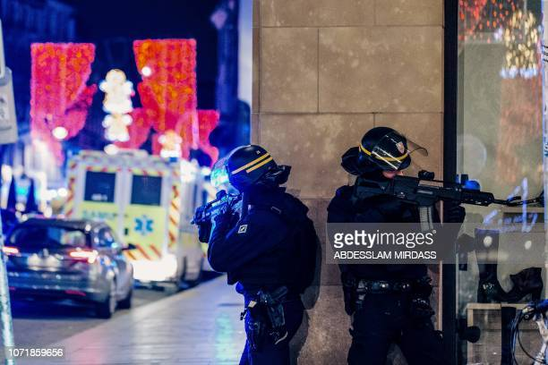 TOPSHOT French police officers stand guard near the scene of a shooting on December 11 2018 in Strasbourg eastern France A gunman killed at least two...