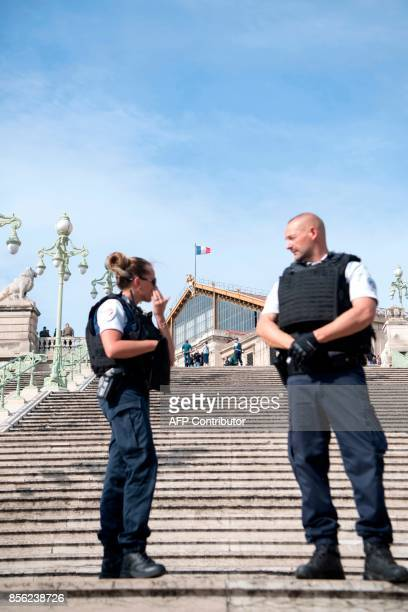 French police officers stand outside SaintCharles train station in Marseille on October 1 after a man armed with a knife killed two people before...