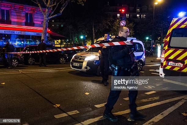 French police officers take security measures around the Bataclan concert hall in Paris France on November 13 after deadly shootings and explosions...