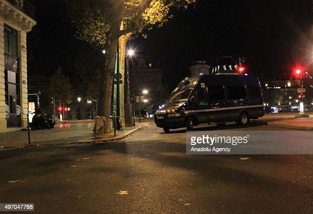 French police officers take security measures around the the Republic Square in Paris France on November 13 after deadly shootings and explosions...