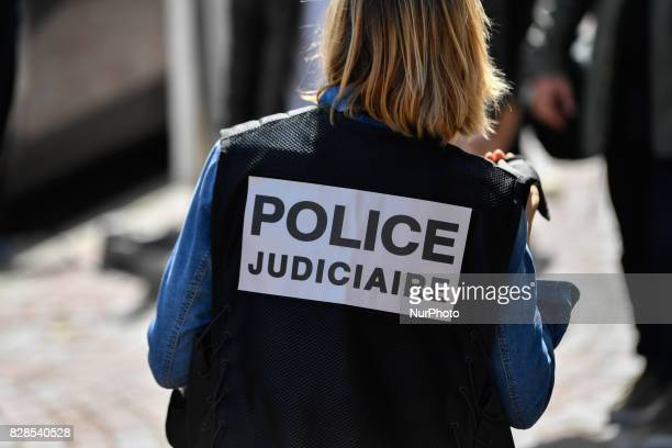 A French police official stands alert at the site after colleagues arrested a suspect on the A16 motorway near Marquise northern France on August 9...