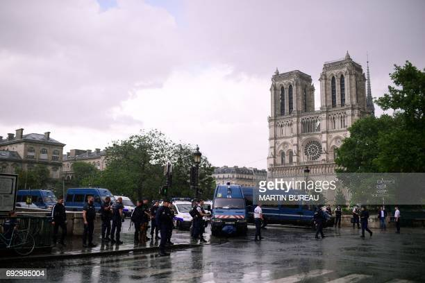 French police officials gather at the entrance to NotreDame cathedral in Paris on June 6 2017 A French police officer has shot and injured a man who...