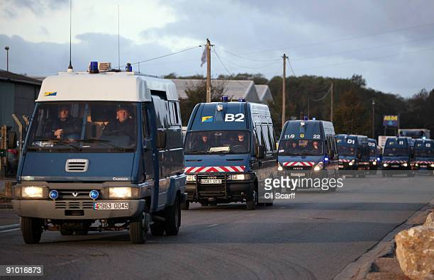 French police riot vans patrol the perimeter of the makeshift migrant camp known as 'The Jungle' adjacent to a ferry terminal to the UK on September...