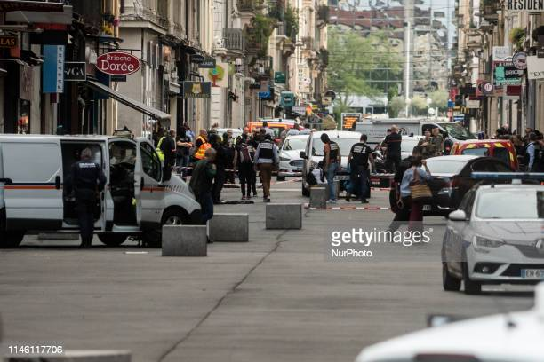 French police search for evidences in front the 'Brioche doree' after a suspected package bomb blast along a pedestrian street in the heart of Lyon...