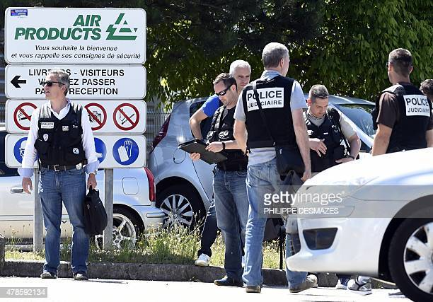 French police secure the entrance of the Air Products company in SaintQuentinFallavier near Lyon central eastern France on June 26 2015 An attacker...