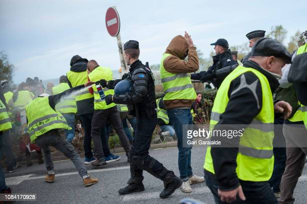 French police uses teargas to disperse yellow vest protesters during a visit by French Foreign Minister JeanYves Le Drian to prepare to launch the...