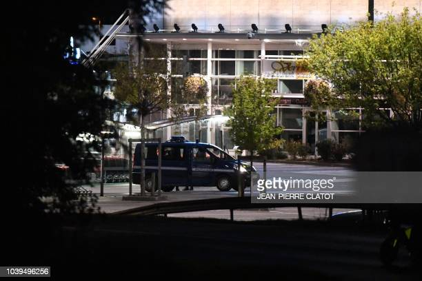 French police van waits in a street of Pont-de-Beauvoisin, the town where eight-year-old girl of Maelys de Araujo was abducted before being murdered...