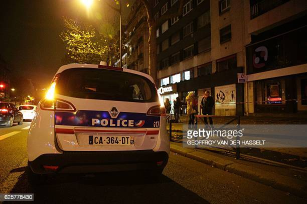 A French police vehicle arrives at the building where British photographer David Hamilton was found dead at his home on November 25 2016 in Paris...