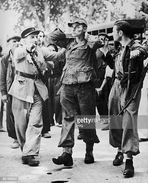 French police with a German prisoner captured by a member of the Resistance in Southern France circa 1944