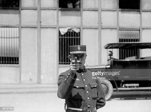 A French policeman aiming his gun during training in Paris