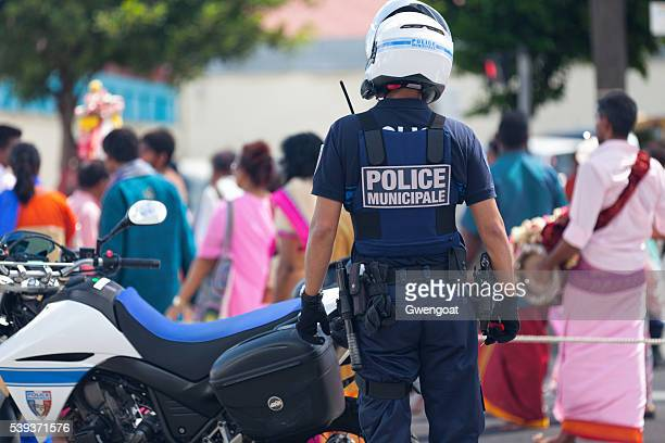 french policeman during a parade - french overseas territory stock pictures, royalty-free photos & images