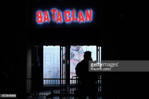 French policeman stands guard in front of the Bataclan concert hall in Paris on November 12 during the concert by British musician Sting to mark the...
