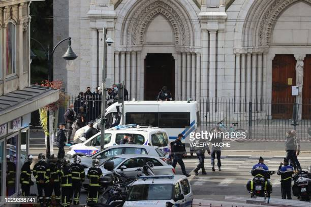 French policemen and firefighters arrive at the site of a knife attack in Nice on October 29, 2020. - France's national anti-terror prosecutors said...