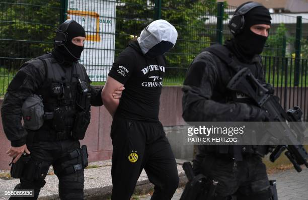 French policemen arrest a man in Strasbourg, on May 13 suspected to be related to a knifeman who killed the day before one man and wounded four other...