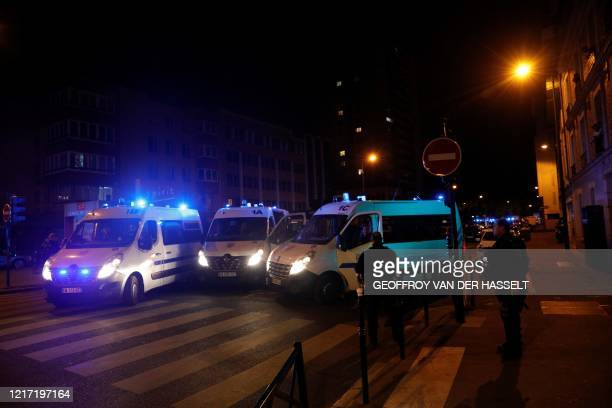 French policemen block a street with their police cars in Clichy, northwest of Paris, on June 2, 2020 following a demonstration against police...