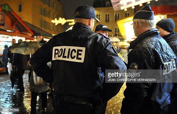 French policemen patrol during the opening of the Christmas market in Metz eastern France on November 21 2015 France revealed on November 19 it will...