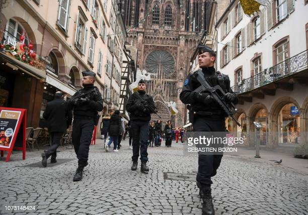French policemen patrol during the reopening of the christmas market of Strasbourg eastern France on December 14 2018 as the author of the attack was...