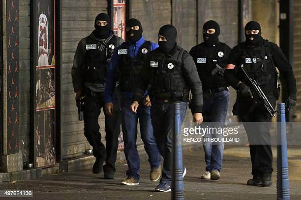 French policemen patrol in the northern Paris suburb of SaintDenis city center on November 18 as French Police special forces raid an appartment...