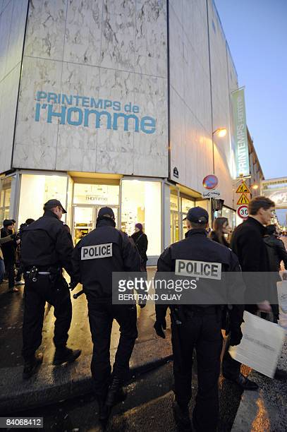 French policemen patrol on December 17 2008 near one of Paris's top department stores Le Printemps a day after an unknown group placed five sticks of...