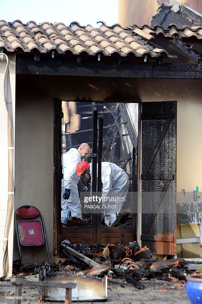 French policemen search index a house where five people were found dead on January 22, 2013 in Garons, near Nimes, southern France