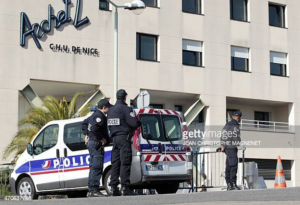 French policemen secure the road during the reconstruction of the murder of Helene Pastor a 77yearold heiress from one of Monaco's richest families...