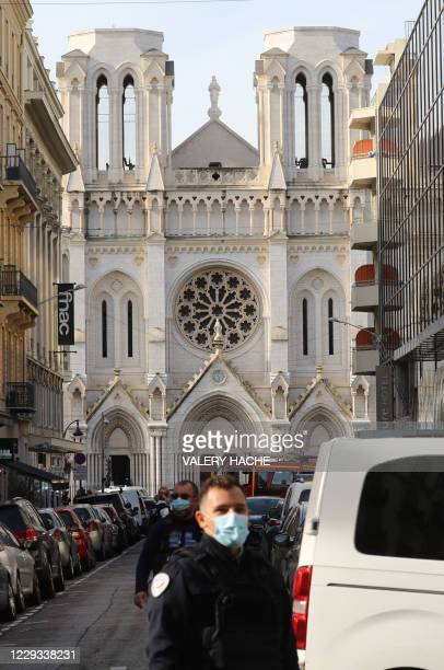 French policemen stand guard a street in front of the Basilica of Notre-Dame de Nice after a knife attack in Nice on October 29, 2020. - A man...