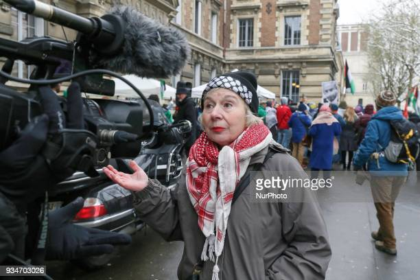 French political activist Olivia Zemor speaks with a journalist during a demonstration on March 19 in front of the court of Versailles near Paris...
