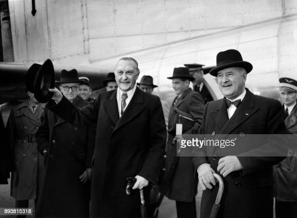 French political economist and diplomat Jean Monnet welcomes German chancellor Konrad Adenauer upon his arrival in Paris on April 13 1951 / AFP PHOTO...
