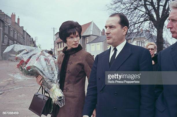 French politician and leader of the Federation of the Democratic and Socialist Left Francois Mitterrand pictured with his wife Danielle Mitterrand as...