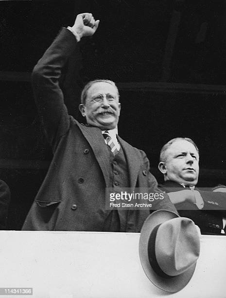 French politician and Prime Minister Leon Blum raises an arm in victory from a podium 1936